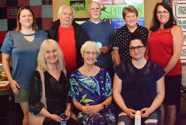 Debbie Blank | The Herald-Tribune<br /> Community Art Show winners at the artists' reception included (front row from left) Rebecca Davies, Judy Glore and Heather Paul; (back row) Amy Lindsey, Fred Craig, Peter Alderucci and Judy Amos. With them is show coordinator Judy Meyer.