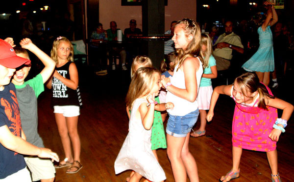 Debbie Blank | The Herald-Tribune<br /> First on the dance floor at the Endless Summer show were kids with adults joining later.