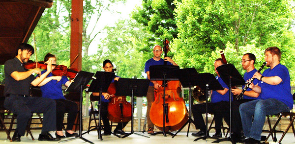 "Debbie Blank | The Herald-Tribune<br /> Seven members of the Cincinnati Queen City Chamber Orchestra played Beethoven pieces during the first half of their concert June 20, then 13 performed Mozart's ""Serenade in B Flat for 13 Winds."" Bailey Brabant, 10, Cedar Grove, commented, ""This is relaxing music."" All 17 took the stage for the finale, a rousing ""Stars and Stripes Forever,"" complete with piccolo."