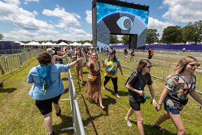 High fives at the entrance to Bonnaroo Music and Arts Festival 2019 in Manchester TN