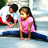Debbie Blank | The Herald-Tribune<br /> Ariana Cisneros Hernandez, 4, Sunman, does the splits while Sophia Hillenbrand, 5, Batesville, makes a chalk drawing.