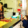 Debbie Blank | The Herald-Tribune<br /> In the pavilion kitchen, Laura Conejo (from left) and Elizabeth Paulsen, Batesville, served nachos, salsa, desserts and drinks to a steady stream of customers, including Neriah, 3, mom Lennie Couch, Batesville, and Joseph, 5. Dad Rick is not pictured. Other servers were Marcela Morales and Naallely Conde.