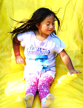 Debbie Blank | The Herald-Tribune<br /> Sofia Ortiz, 5, daughter of Balfred and April Ortiz, enjoys the bouncy house slide.
