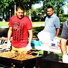 Debbie Blank | The Herald-Tribune<br /> Batesville's first Fiesta Hispana was Sept. 29 at Liberty Park. The event, sponsored by the Hispanic Community Advisory Committee of Batesville, offered authentic food, music, dancing and kids' activities. Manning the outdoor cooking area were (from left) Nidia Hernandez, Rosendo Alvarez, Gregorio Nuñez, Ricardo Camarena and Hector Meneses, Batesville. Other volunteers here were Victor Cisneros and Juan Hernandez, Sunman. Attendees could order duritos (a crunchy snack topped with salsa) and a variety of tacos and tamales, then choose from among four sauces.