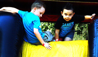 Debbie Blank | The Herald-Tribune Brothers Landyn Jones (left), 7, and Alessandro Hernandez, 5, check out the bouncy house. Their parents are Jose Hernandez and April Wagner, Batesville.