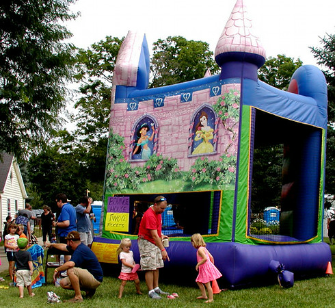 Debbie Blank | The Herald-Tribune<br /> A kids' area located behind the old stone church on Pearl Street boasted a crafts and game tent plus a large bounce house.