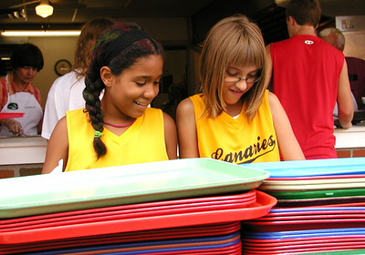 Debbie Blank | The Herald-Tribune<br /> It takes an army of volunteers to put on a fest that grows each year. Canaries softball teammates Makayla Granger (left), 9, and Kachina Slayback, 10, Batesville, organize trays, silverware and napkins in the dinners area.