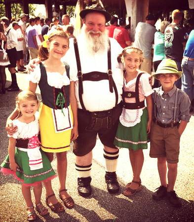 Batesville High School German teacher Andy Koors (center) congratulates the winners of the Freudenfest costume contest. They are the children of Charlie and Kate Beiser, Oldenburg:  Elena (from left), 4; Audrey, 10; Maggie, 8; and Owen, 6.