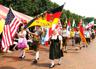 "Debbie Blank | The Herald-Tribune At the favorite Oldenburg festival, spectators can count on a parade of flags plus German bands and dancers, vast amounts of beer, athletic events, a pie auction, ""The Schnitzelbank"" singalong, colorful decorations, inside jokes and many other traditions. Please see more photos of the July 18-19 extravaganza on page 4."