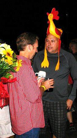 Debbie Blank | The Herald-Tribune<br /> Catching up on Friday night: As each summer of Freudenfest arrives, men become less shy about throwing on funny hats and costumes.