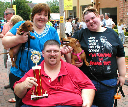 Debbie Blank   The Herald-Tribune<br /> The second-fastest dachshund in Saturday's final race was Missy, 4 (right), owned by (from left) Donna, Delbert and daughter Katelyn Felix, Osgood. Cheering the dog on was Maggie, 5.