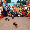 Debbie Blank | The Herald-Tribune<br /> Dachshunds were definitely outnumbered by a curious mob watching preliminary races and the final at 2 p.m. Saturday on Pearl Street in Oldenburg.