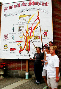 "Debbie Blank | The Herald-Tribune With special pointers for each German item, Princesses of Schist (from left) Karen Munchel, Deann Kaiser and Jackie Wilhelm lead the crowd in singing ""The Schnitzelbank."""