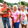 Debbie Blank | The Herald-Tribune<br /> For the second year in a row, Roxy, 4, a miniature dappled dachshund owned by Daniel (from left), Amy and Holly Bryan, Batesville, has won that race.