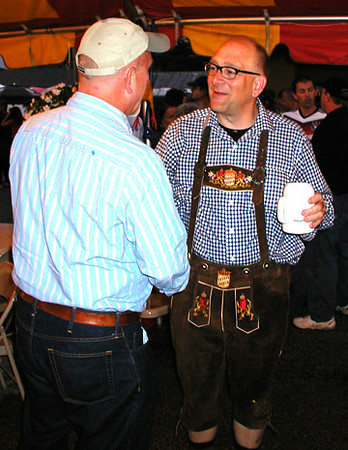 Debbie Blank | The Herald-Tribune<br /> Leon Enneking (left), Oldenburg, bids farewell to Michael Cambron, Batesville. Cambron, dressed appropriately, is moving to a Hill-Rom job in Germany.