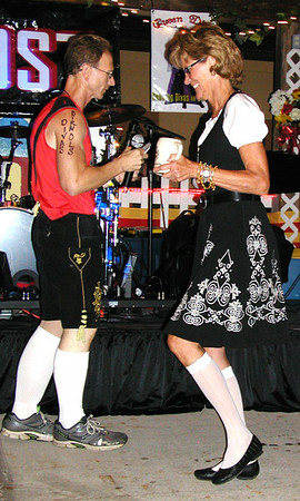 Debbie Blank | The Herald-Tribune<br /> Paul Brockman (left), the mastermind behind wacky Friday night fest activities, dances with contestant Alice Schwegman.