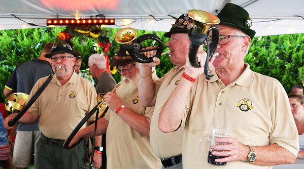 Debbie Blank | The Herald-Tribune<br /> Germania Jagedhorn Blasergruppe, a hunting horn group, went from tent to tent entertaining folks with their stirring music.