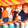 Debbie Blank | The Herald-Tribune<br /> Alice Raver, working in one of the food booths, was one of many, many volunteers needed to make the festival a success.