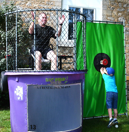 Diane Raver | The Herald-Tribune<br /> Kurt Enneking, Ripley County Sheriff's Department chief deputy, had fun in the dunk tank and ended up in the water numerous times.