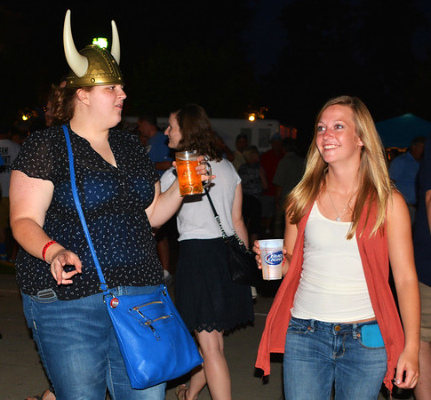 Debbie Blank | The Herald-Tribune<br /> It's definitely acceptable to wear costumes and headgear (not always German) at the fest.
