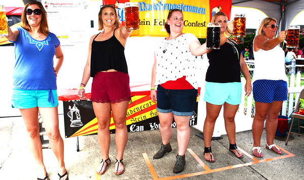 Diane Raver | The Herald-Tribune<br /> Women proved the stein holding contest was not just a male domain.