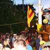 Debbie Blank | The Herald-Tribune<br /> At sunset Friday, spectators admire a giant 40th birthday cake atop the combination town hall and firehouse.
