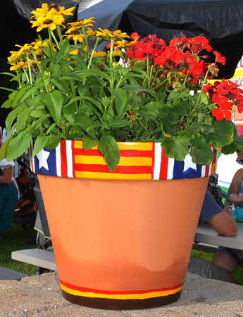 Debbie Blank | The Herald-Tribune<br /> The German flag colors -- red and yellow -- were prevalent on decorations, including fresh flowers.
