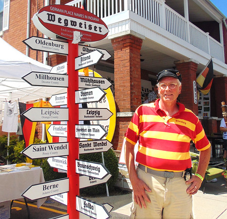Diane Raver | The Herald-Tribune<br /> This fest-goer, dressed in the German flag colors, learns that the Oldenburg place name is one of about 10 German names in Indiana.