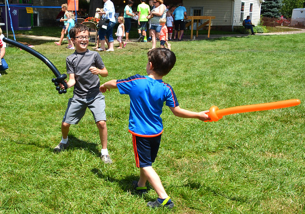 Diane Raver | The Herald-Tribune<br /> Kentucky brothers Leo (left), 9, and Vinny D'Ambrosio, 6, had a fight with their balloon swords.