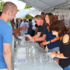 Debbie Blank | The Herald-Tribune<br /> It's not surprising beer booth volunteers didn't get a minute's rest.