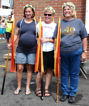 "Diane Raver | The Herald-Tribune<br /> Freudenfest princesses Deanne Kaiser (from left), Jackie Wilhelm and Karen Munchel prepared to lead a mass singing of ""The Schnitzelbank Salute."""
