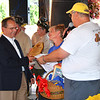 Debbie Blank | The Herald-Tribune<br /> The two-day Freudenfest got off to a flying start at its July 15 opening when Mark Dunevant (left) presented the Freudenfest Committee with a $25,000 check in honor of his parents, Robert and Helen, who loved Oldenburg. Then Jackie Wilhelm and fest chair Gary Munchel gave him a plaque and basket of German goodies to thank him for the family's generosity. The committee uses all proceeds to improve the village.