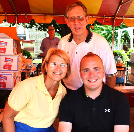 Diane Raver | The Herald-Tribune<br /> Kiwanians Ed Krause (clockwise from top), Justin Tucker and Dr. Jere Schoettmer worked at the club's food tent.