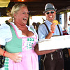 Debbie Blank | The Herald-Tribune<br /> In honor of the 40th birthday, one costumed volunteer passes out snickerdoodles. Others distributed cake pops to Friday night guests.