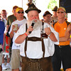 "Debbie Blank | The Herald-Tribune<br /> Batesville High School German teacher Andy Koors coaches the crowd in singing ""Happy Birthday"" in that language."