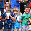 Diane Raver | The Herald-Tribune<br /> Youngsters with colorful hair enjoy treats while waiting for the dog races to begin.