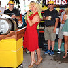 "Debbie Blank | The Herald-Tribune<br /> After the ceremonial first keg was presented during Friday's opening, Regina Siefert (center) sang ""Happy Birthday"" Marilyn Monroe style as Oldenburg residents Scott Cooper (left) and Greg Struewing listen. The weekend marked Freudenfest's 40th year as a summer reunion tradition."