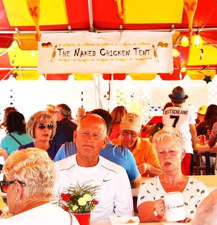 Debbie Blank | The Herald-Tribune<br /> Not too many festivals can claim to have a Naked Chicken Tent ....