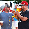 "Debbie Blank | The Herald-Tribune<br /> On Friday evening, Matt Starost (left), Indianapolis, chats with Brian Dietz, Harrison, Ohio, who reports, ""You can bring your own steins in."""