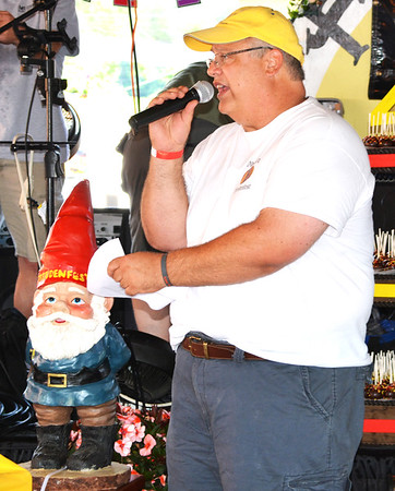 Debbie Blank | The Herald-Tribune<br /> Fest chairman Gary Munchel begs spectators to enter the Name the Freudenfest Gnome Contest.
