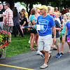 Debbie Blank | The Herald-Tribune<br /> Oldenburg resident Eric Heppner leads a group of kids through the throngs Friday night.