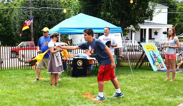 Diane Raver | The Herald-Tribune<br /> Persons young and old tried their luck at the flying chicken toss to win prizes.