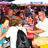 Debbie Blank | The Herald-Tribune<br /> With smiling faces, fresh flowers, white lights and picnic tables, the event is a great time to catch up with friends and neighbors.