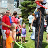 Diane Raver | The Herald-Tribune<br /> Youngsters were amazed at two Cincinnati Circus stilt walkers who made balloon creations for them.