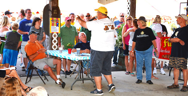 Debbie Blank | The Herald-Tribune<br /> Chair Gary Munchel tries to get a handle on how many have attended all 40 Freudenfests. It's more than you think.