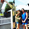 Debbie Blank | The Herald-Tribune<br /> Emily (Mehlon) Stickley (center), Columbus, Ohio, and Kristen Biltz, Batesville, pose near the German holding a beer mug landmark.