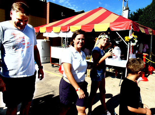 Debbie Blank | The Herald-Tribune<br /> Randy and Amy Streator, Batesville, arrive at the fest with children Catherine, 11, and Grant, 6.