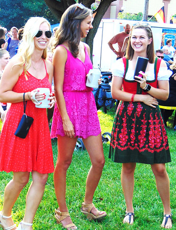 Debbie Blank | The Herald-Tribune<br /> Chelsea Eckstein (from left) and Kerri Meyer, Batesville, and Erin Tekulve, Oldenburg, enjoy the music and catching up.