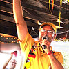 "Debbie Blank | The Herald-Tribune<br /> Freudenfest Steering Committee member Troy Ilderton leads the opening night crowd in a beer-raising ""Pros't!"" in memory of the late Batesville High School German teacher Andy Koors, a fest fixture. Ilderton called him ""so much more than lederhosen ... he was a great teacher and travel guide."""