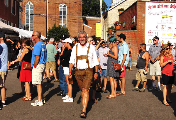 Debbie Blank | The Herald-Tribune<br /> A man in German garb breezes past the very long beer ticket line.